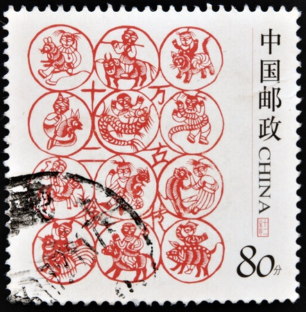 CHINA - CIRCA 2005: A stamp printed in China shows Chinese zodiac signs, circa 2005 photo