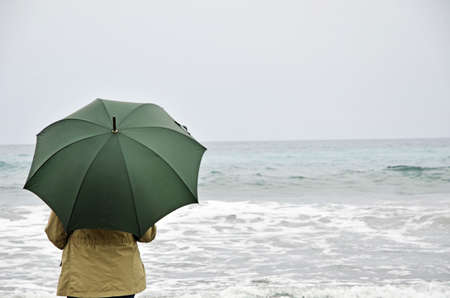 woman with umbrella on the beach photo