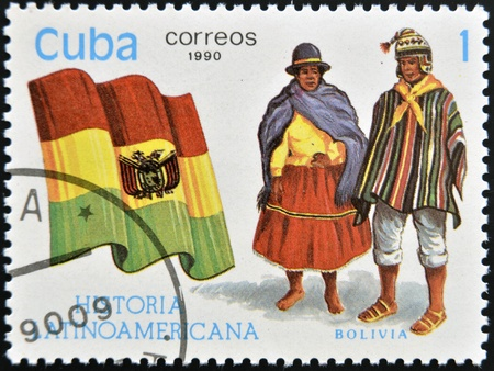 CUBA - CIRCA 1990: A stamp printed in Cuba dedicated to Latin American history, shows typical costume and flag of Bolivia, circa 1990 Stock Photo - 13291979