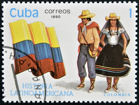 CUBA - CIRCA 1990: A stamp printed in Cuba dedicated to Latin American history, shows typical costume and flag of Colombia, circa 1990 Stock Photo - 13291924
