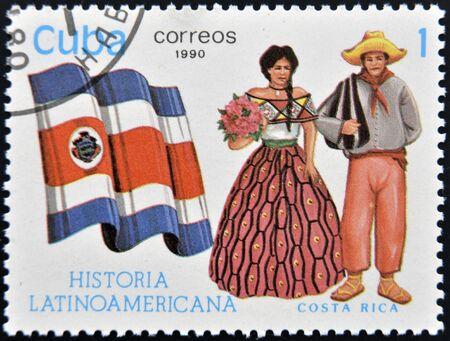 CUBA - CIRCA 1990: A stamp printed in Cuba dedicated to Latin American history, shows typical costume and flag of Costa Rica, circa 1990