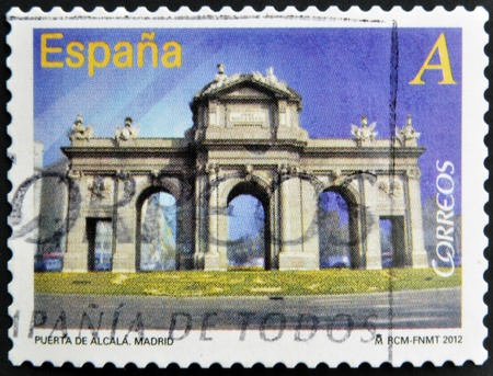 SPAIN - CIRCA 2012: A stamp printed in Spain dedicated to arches and monumental gates, shows Puerta de Alcala in Madrid, circa 2012 photo