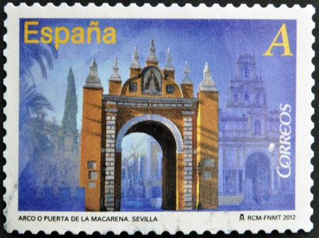 SPAIN - CIRCA 2012: A stamp printed in Spain dedicated to arches and monumental gates, shows Arc or Puerta de la Macarena in Seville, circa 2012