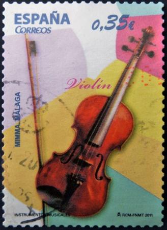 SPAIN - CIRCA 2011: A stamp printed in Spain shows a violin, circa 2011 Stock Photo - 13286058