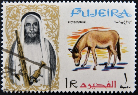 fujeira: FUJEIRA - CIRCA 1965: A stamp printed in Fujeira shows donkey, circa 1965 Editorial