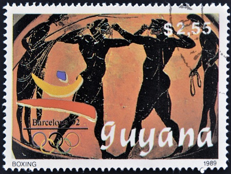 GUYANA - CIRCA 1989: A stamp printed in Guyana dedicated to Barcelona, shows detail of Greek ceramics, with boxers, circa 1989  photo