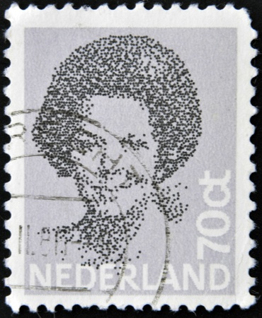regnant: HOLLAND - CIRCA 2002: A stamp printed in the Netherlands, shows Beatrix of the Netherlands, circa 2002