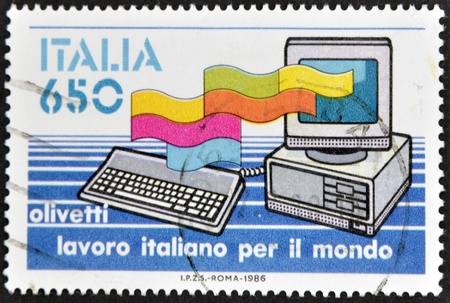 ITALY - CIRCA 1986: A stamp printed in Italy dedicated to Italian job for the world, shows a computer Olivetti, circa 1986 Stock Photo - 13285430