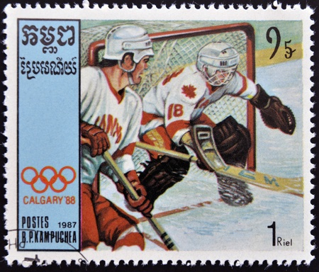 CAMBODIA - CIRCA 1987: A stamp printed in Cambodia shows Canadian team players, ice hockey, circa 1987