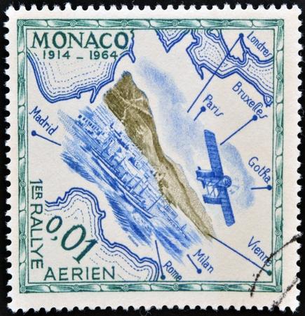 MONACO - CIRCA 1964: A stamp printed in Monaco shows air rally, circa 1964MONACO - CIRCA 1964: A stamp printed in Monaco shows first air rally, circa 1964 photo