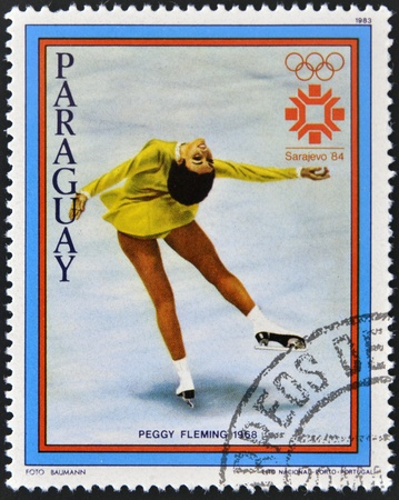 PARAGUAY - CIRCA 1983: A stamp printed in Paraguay shows Peggy Fleming, circa 1983 Stock Photo - 13289373