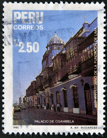 founding: PERU - CIRCA 1985: A stamp printed in Peru commemorating the 450th anniversary of the founding of Lima, showing the palace Osambela, circa 1985