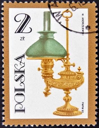 POLAND - CIRCA 1982: A stamp printed by Poland shows antique oil lamp, circa 1982  photo