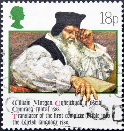 UNITED KINGDOM - CIRCA 1988: a stamp printed in the Great Britain shows William Morgan Bible translator, circa 1988  Stock Photo - 13289168