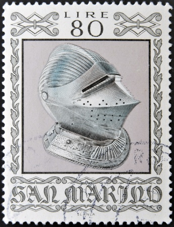 SAN MARINO - CIRCA 1974: A stamp printed in San Marino dedicated to Ancient Weapons from Cesta Museum, shows Sallet Helmet, circa 1974  Stock Photo - 13291768