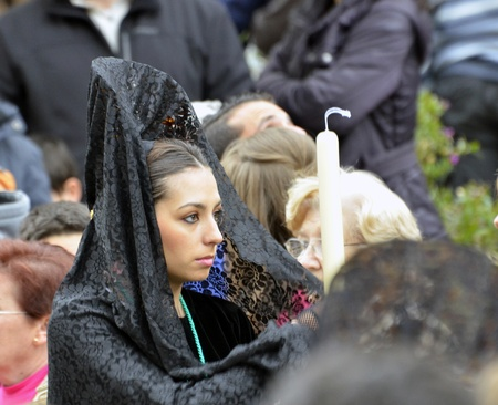 GRANADA, SPAIN - APRIL 6: Female participant in Easter Procession on April 6, 2012 in Granada, Spain. The woman carries the traditional head coverage called mantilla  Stock Photo - 13289203