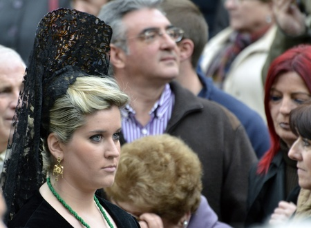 GRANADA, SPAIN - APRIL 6: Female participant in Easter Procession on April 6, 2012 in Granada, Spain. The woman carries the traditional head coverage called mantilla  Stock Photo - 13289218