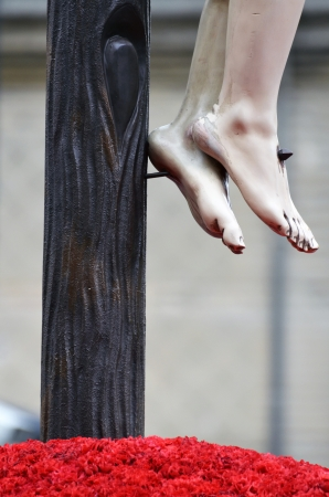 detail of the feet of the crucified Christ in procession in Granada, Spain photo