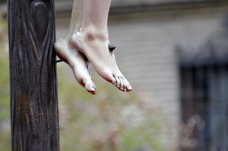 jesus cross: detail of the feet of the crucified Christ in procession in Granada, Spain Stock Photo