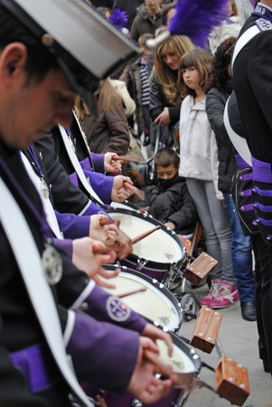 GRANADA, ANDALUSIA, SPAIN - APRIL 6: Music band the penitents of the brotherhood in typical procession Holy Week  in April 6, 2012 in Granada, Andalusia, Spain