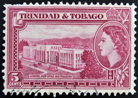 TRINIDAD AND TOBAGO - CIRCA 1950: A stamp printed in Trinidad shows General Post Office and Treasury, circa 1953