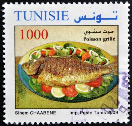 TUNISIA - CIRCA 2009: A stamp printed in Tunisia shows grilled fish, circa 2009 photo