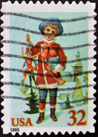 UNITED STATES OF AMERICA - CIRCA 1995: A stamp printed in USA shows  the boy with gifts, circa 1995  Stock Photo - 13285834