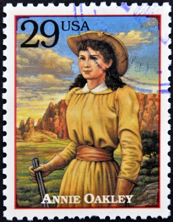 UNITED STATES OF AMERICA - CIRCA 1994 : Stamp printed in USA shows Annie Oakley, American sharpshooter and exhibition shooter in old west , circa 1994