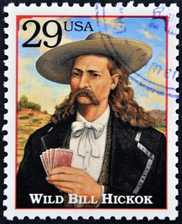 gunfighter: UNITED STATES OF AMERICA - CIRCA 1994 : Stamp printed in the USA with portrait Wild Bill HickoK, gunfighter, scout, lawman, circa 1994