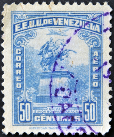 UNITED STATES OF VENEZUELA - CIRCA 1950: A stamp printed in Venezuela shows statue of Simon Bolivar in Caracas, circa 1950 photo