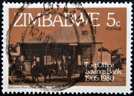 ZIMBABWE - CIRCA 1980: A stamp printed in Zimbabwe shows Gatooma Post Office 1912, circa 1980 Stock Photo - 13291944