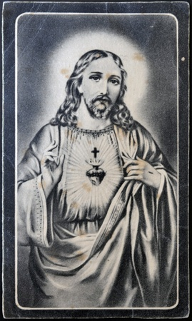 SPAIN - CIRCA 1949: A postcard printed in Spain shows Sacred Heart of Jesus, circa 1949