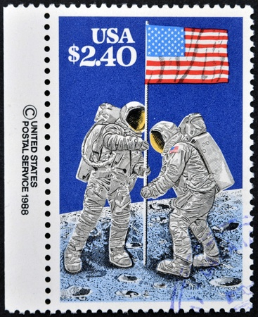 manned: UNITED STATES OF AMERICA - CIRCA 1988: A stamp printed in USA shows Astronauts planting Flag on Moon, 20th Anniversary of First Manned Moon Landing, circa 1988 Editorial