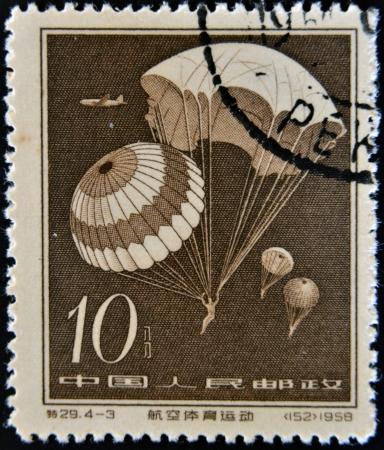 CHINA - CIRCA 1958: A stamp printed in china shows Parachute jump, circa 1958 Stock Photo - 13749315