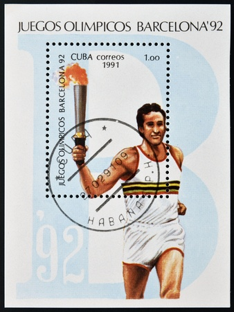 the olympic games: CUBA - CIRCA 1991: A stamp printed in Cuba dedicated to Olympic Games of Barcelona 1992, shows athlete with the Olympic flame, circa 1991