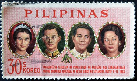 bhumibol: PHILIPPINES - CIRCA 1965: A stamp printed in Philippines dedicated to Visit of King Bhumibol & Queen Sirikit of Thailand, circa 1965