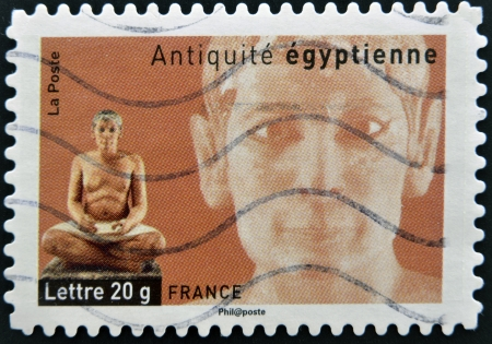 FRANCE - CIRCA  2007: A stamp printed in France dedicated to ancient Egypt, shows sculpture of a seated scribe, circa 2007