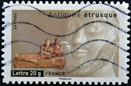 spouses: FRANCE - CIRCA  2007: A stamp printed in France dedicated to ancient Etruscans, shows coffin burial of spouses, circa 2007