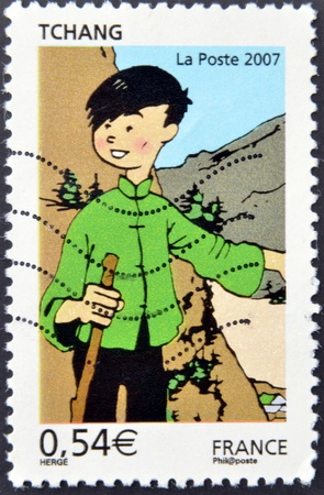 FRANCE - CIRCA 2007: A stamp printed in France shows Chang Chong-Chen, great friend of Tintin, circa 2007   photo