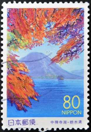 honshu: JAPAN - CIRCA 1999: A stamp printed in Japan shows Nantai Volcano, Honshu, circa 1999