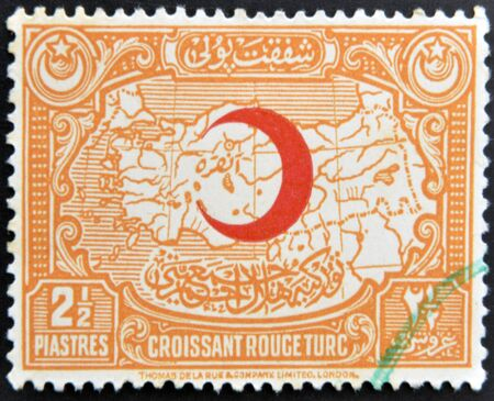 TURKEY - CIRCA 1940: A stamp printed in Turkey shows the red crescent on the map of turkey, circa 1940 Stock Photo