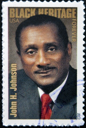 usps: UNITED STATES OF AMERICA - CIRCA 2012: A stamp printed in USA shows the portrait of John H. Johnson, Black Heritage, circa 2012