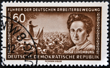 political economist: GERMANY - CIRCA 1974: A stamp printed in the democratic republic of germany shows Rosa Luxemburg, circa 1974