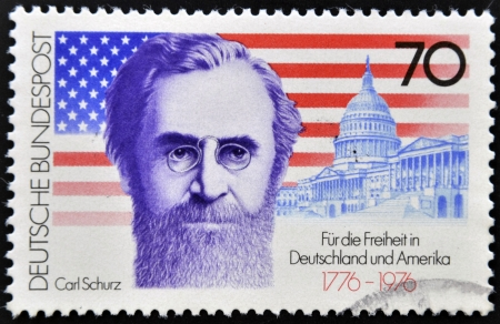 GERMANY - CIRCA 1976: a stamp printed in the Germany shows Carl Schurz, American Flag and Capitol, circa 1976  Stock Photo - 13877202