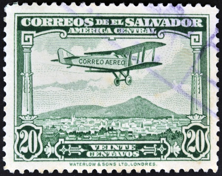 EL SALVADOR - CIRCA 1940: A stamp printed in el Salvador shows plane flying over El Salvador, circa 1940 photo