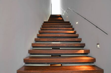 light at the end of the wooden stairs photo