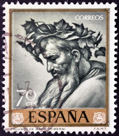 bacchus: SPAIN - CIRCA 1963: A stamp printed in Spain shows The Triumph of Bacchus by Jose de Ribera, circa 1963