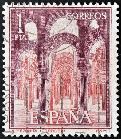 SPAIN - CIRCA 1964: a stamp printed in the Spain shows Interior of La Mezquita,  Cordoba, Andalusia, circa 1964  photo