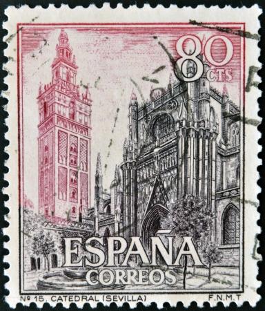 SPAIN - CIRCA 1965: A stamp printed in Spain shows Cathedral and Giralda, Sevilla, circa 1965 Stock Photo - 13874858