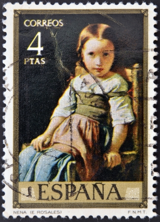 rosales: SPAIN - CIRCA 1974: A stamp printed in spain shows the painting baby by Eduardo Rosales, circa 1974